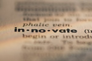 Close up of innovate definition