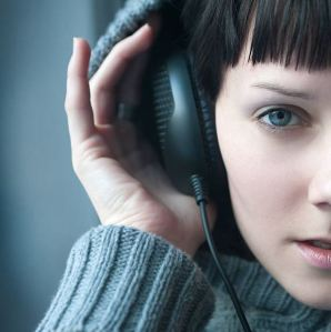 sight and sound woman with headphones