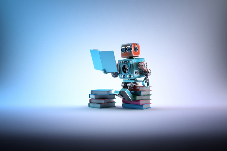 robot sitting on books the future