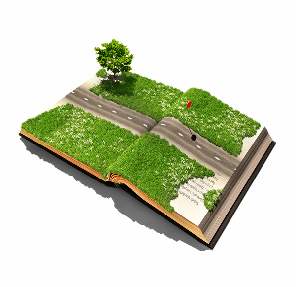 An open book covered with grass and bisected by a road crossing from page to page.