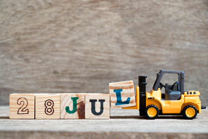 Toy forklift hold block l to complete word 28 jul on wood background (Concept for calendar date in month July)